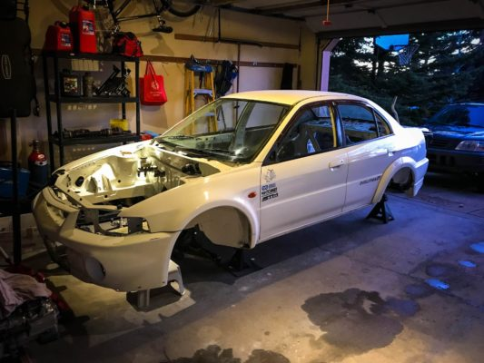 Gutted Evo 6 on Jack Stands