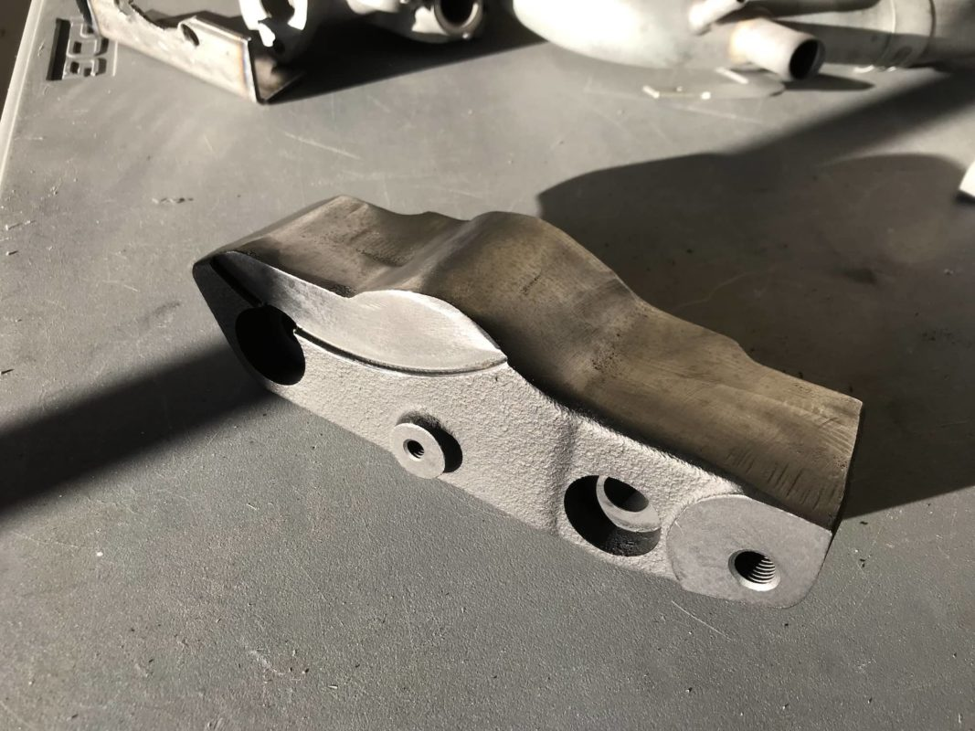 Finished power steering delete bracket for Evo 6